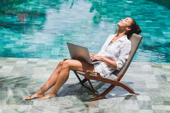 Why I Chose to Work During My Summer Vacation: https://g.foolcdn.com/editorial/images/538530/woman-typing-on-laptop-while-relaxing-next-to-pool_gettyimages-924645428.jpg