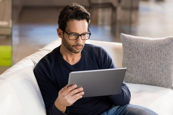 27% of Americans Have Decreased or Stopped Retirement Plan Contributions Due to the Coronavirus: https://g.foolcdn.com/editorial/images/588487/man-sitting-on-couch-using-tablet_gettyimages-514330846.jpg