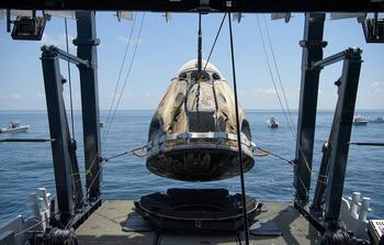 SpaceX Safely Completes Its First Crewed Mission: https://g.foolcdn.com/editorial/images/585486/spacex-crew-dragon-endeavour-being-lifted-aboard-recovery-ship-is-nasa.jpg