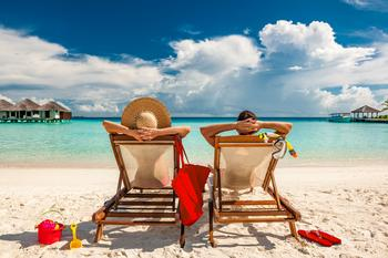 Here's What People Are Willing to Give Up in Order to Retire Early: https://g.foolcdn.com/editorial/images/532546/man-and-woman-relaxing-in-lounge-chairs-on-a-beach-in-the-maldives-mature-couple-vacation-early-retirement.jpg