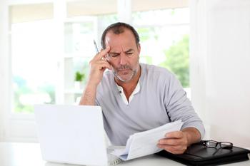 A Third of Adults Age 50 and Over Aren't Prepared for Retirement: https://g.foolcdn.com/editorial/images/532060/man-looking-at-paper-document-concentrating-confused.jpg