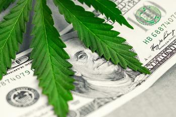 Aurora Cannabis Divests The Green Organic Dutchman Stake: https://g.foolcdn.com/editorial/images/538940/marijuana-leaf-atop-a-100-dollar-bill.jpg